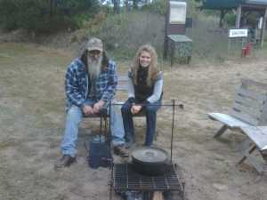 Cooking venison over a open pit fire